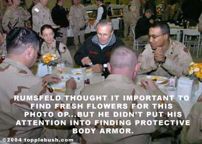 Rumsfeld dining with troops in Iraq for photo op